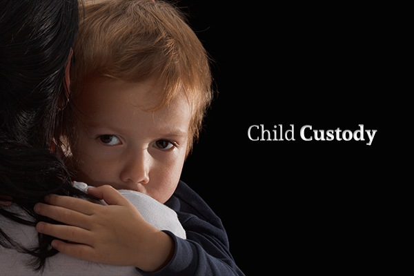 "A child being held by his mother beside the words ""Child Custody"""