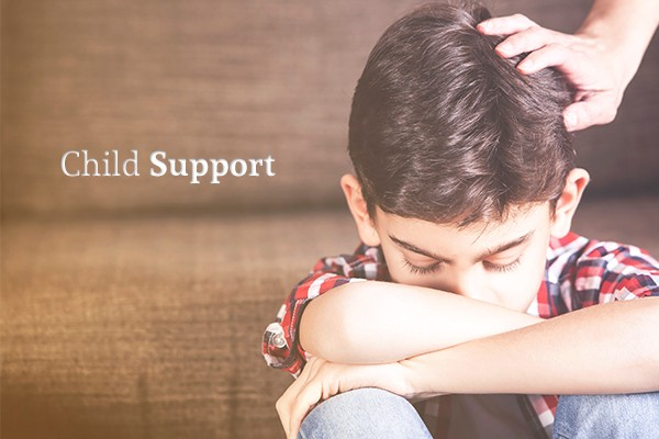 "A picture of a child looking dejected, his head down, arms crossed over his knees, with a comforting hand on his head beside the words ""Child Support"""