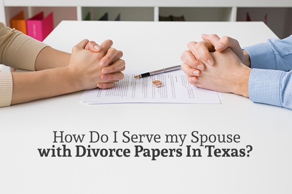 "A man and a woman sit across from each other at a white table with documents between them above the words ""How Do I Serve my Spouse with Divorce Papers In Texas"""