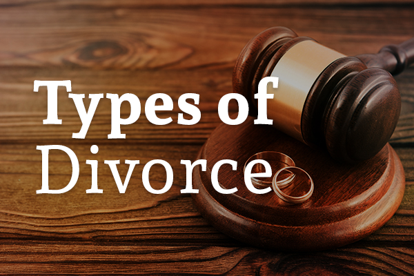 A gavel on a wooden desk with two rings and the words, types of divorce.