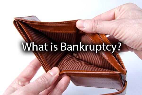 An individual looking at an empty wallet with the words, what is bankruptcy?